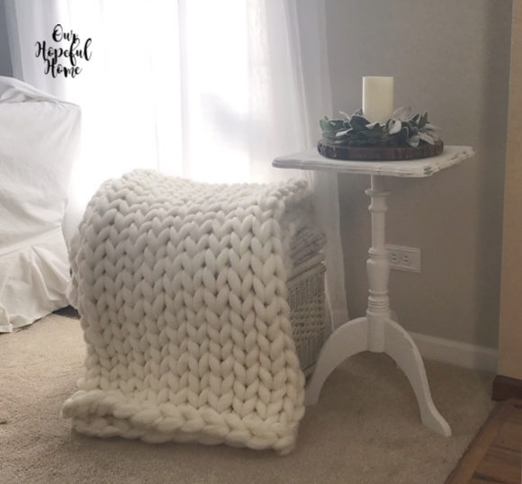 large cream colored chunky knit blanket