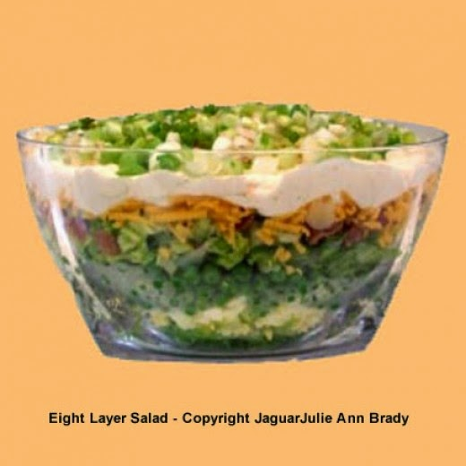 eight layer salad in acrylic bowl