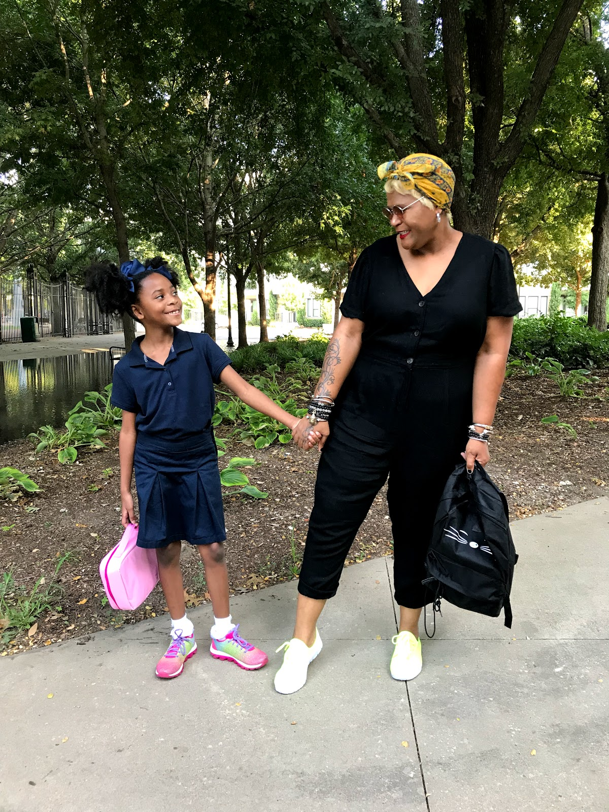Image; Tangie Bell walking and talking with her daughter before school. Sharing a quick school morning routine