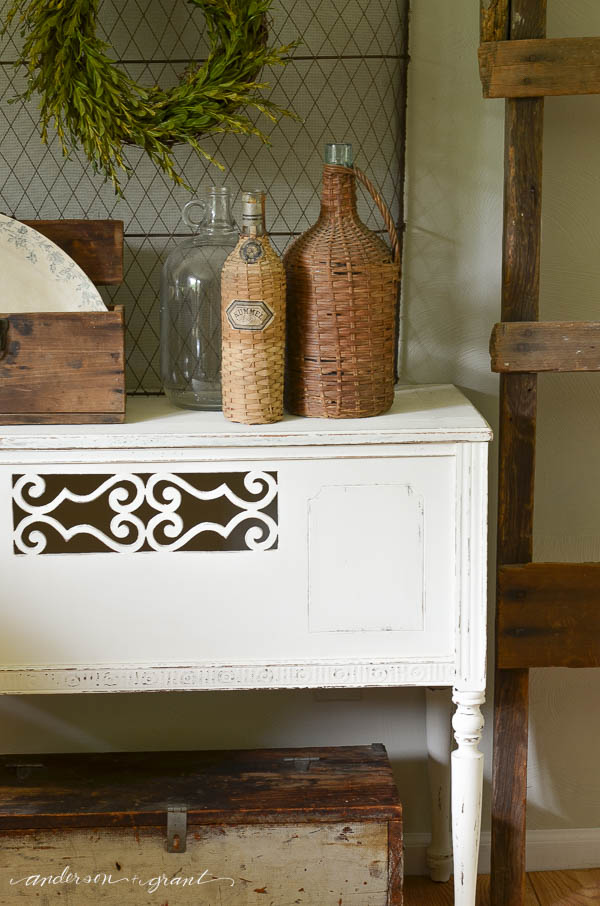 Boxwood and vintage finds make a unique display in any home.  Check out this post for ideas on adding a little character to your space.  |  www.andersonandgrant.com