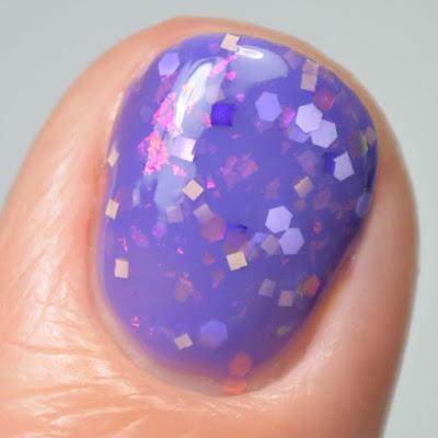 purple glitter nail polish close up