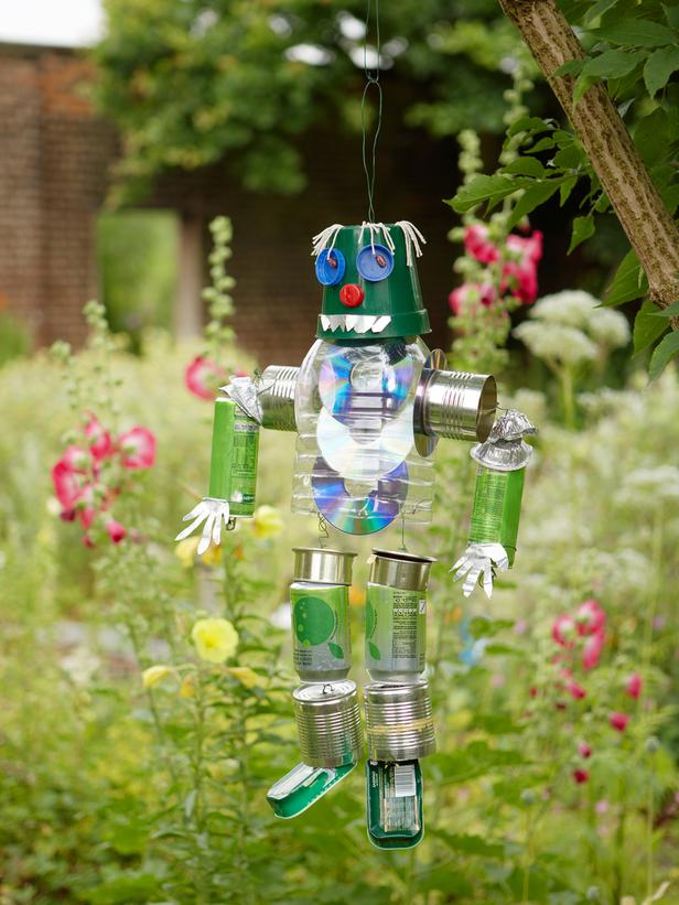 Make a tin can man in your garden for Garden ornaments from recycled materials
