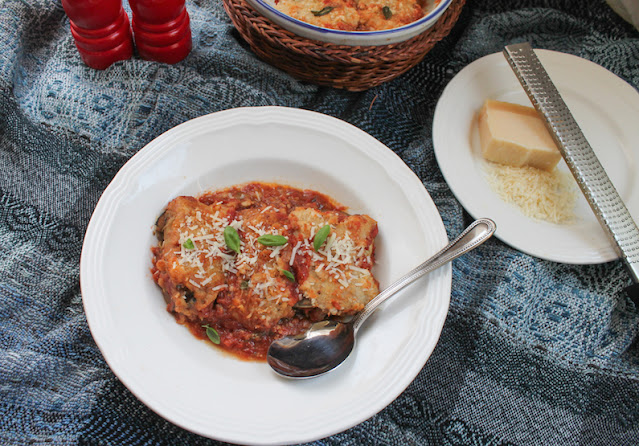 Food Lust People Love: These cheesy eggplant pork roast rolls are filled with pork, eggplant and mozzarella, baked in a fresh garlicky tomato sauce, then topped with more cheese.