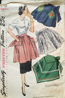 Vintage pattern shows four variations of the half apron. Three are gathered and one is triangular. Square and diamond pockets are also shown.