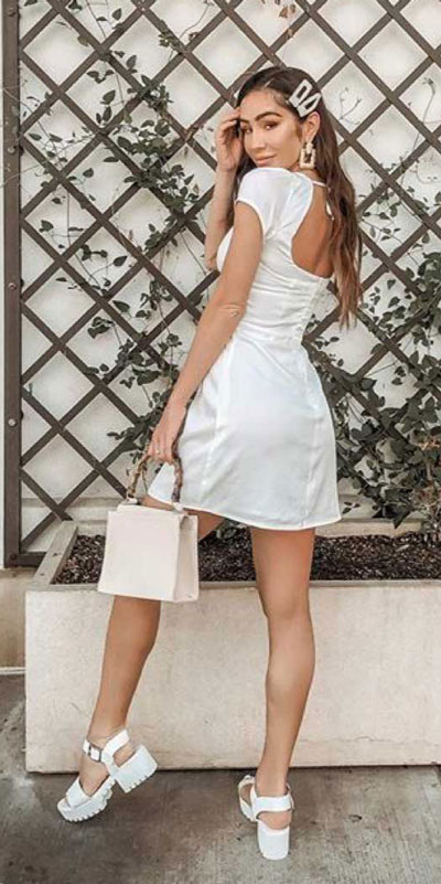 Capture everyone's attention with these latest summer looks. 27 Trending Summer Outfits by Stylish Instagram Influencers. Summer Styles via higiggle.com | mini dress | #summeroutfits #instagram #style #minidress