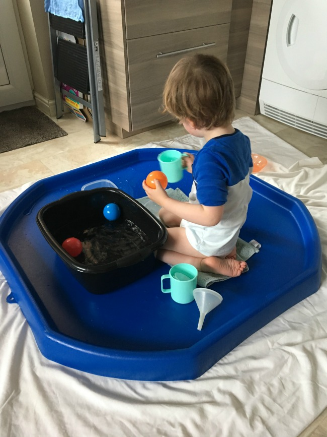 our-weekly-journal-27-march-toddler-playing-with-water-in-a-tuff-tray
