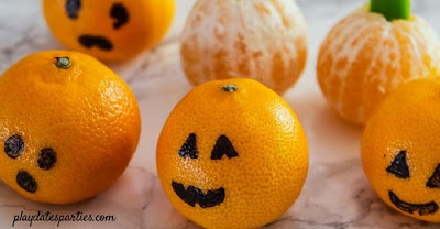 Halloween Pumpkins Made from Oranges