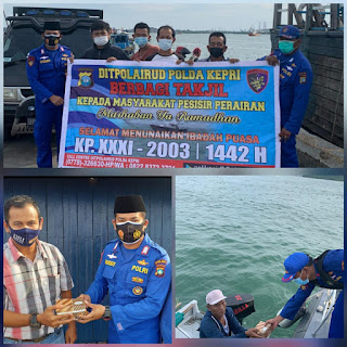 Ditpolairud  kapal patroli.XXXl-2003 Polda Kepri Berbagi takjil Kepada masyarakat  perairan Pesisir kota Batam