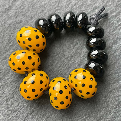 Handmade lampwork glass beads made with Creation is Messy Scotch Broom