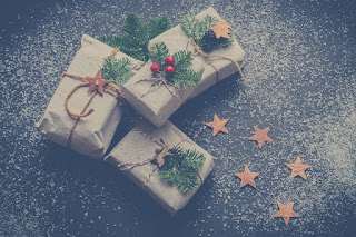Christmas gifts wrapped in brown paper and tied with string