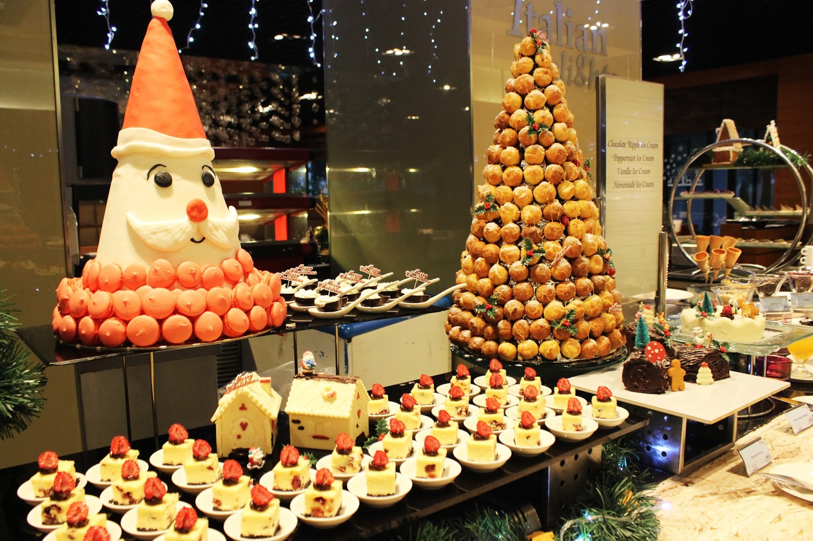 100f3bbdd6f55 The dessert table is all pomp and pleasure. The holiday treats include  Chocolate Yule Log
