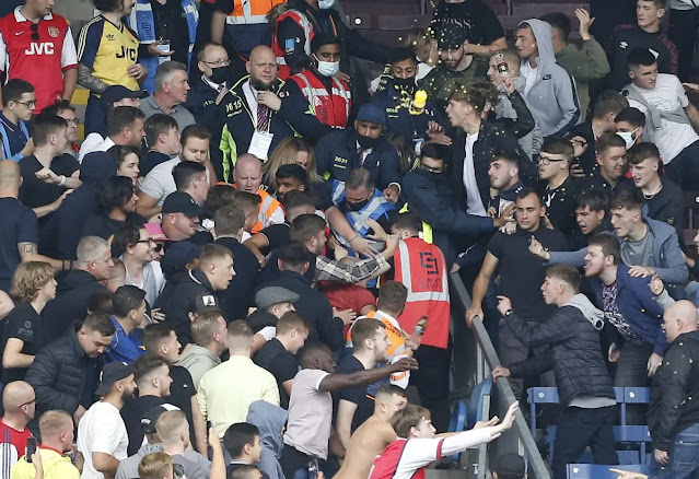 The crowd created a chaotic scene on Turf Moor field.