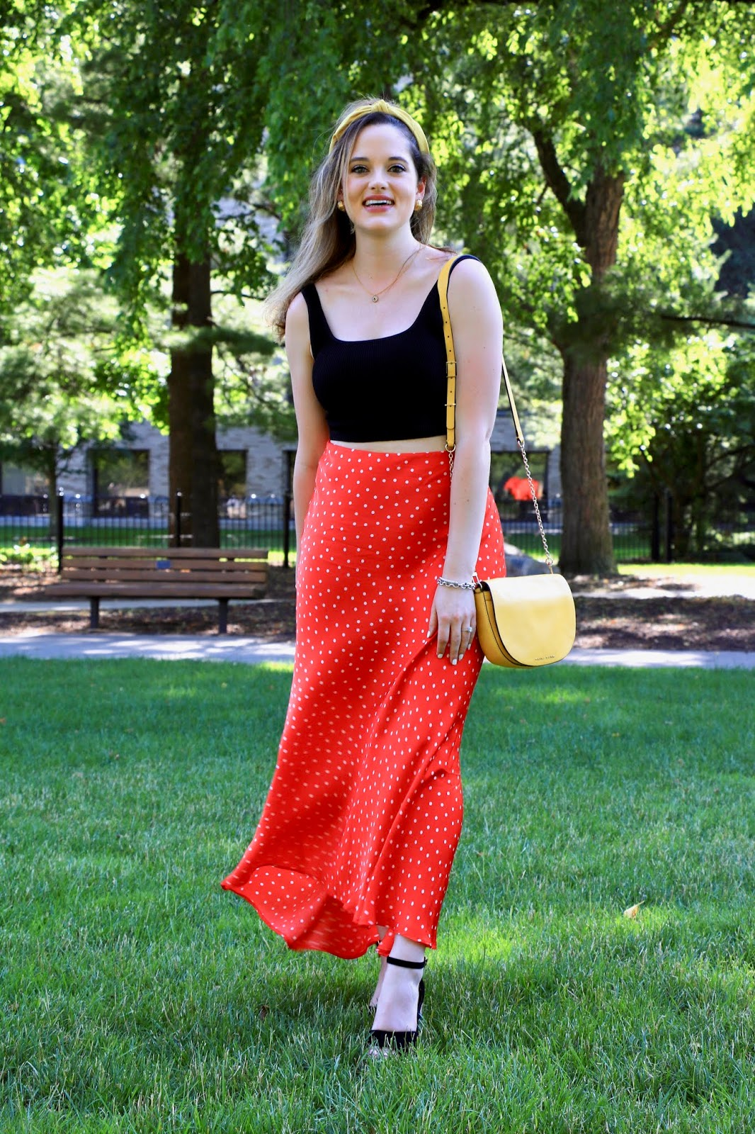 Nyc fashion blogger Kathleen Harper's summer date night outfit idea of a crop top and high-waisted maxi skirt.