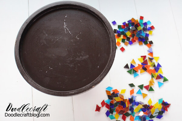 STEP 1 OF HOW TO MAKE A MOSAIC RESIN CAKE STAND: Begin by sorting your glass mosaic pieces and deciding on the colors, shapes you want to use. You can do a dry run if you'd like.
