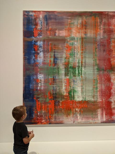 Kid looking at Abstract Art