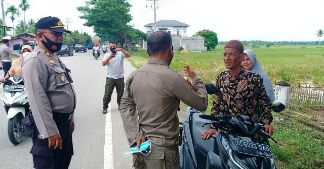 Kapolsek Simpang Ulim Pimpin Operasi Yustisi Penerapan Protokol Kesehatan