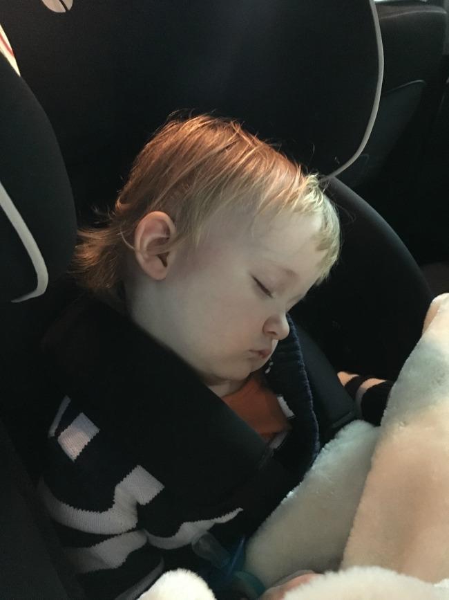 toddler asleep in car seat
