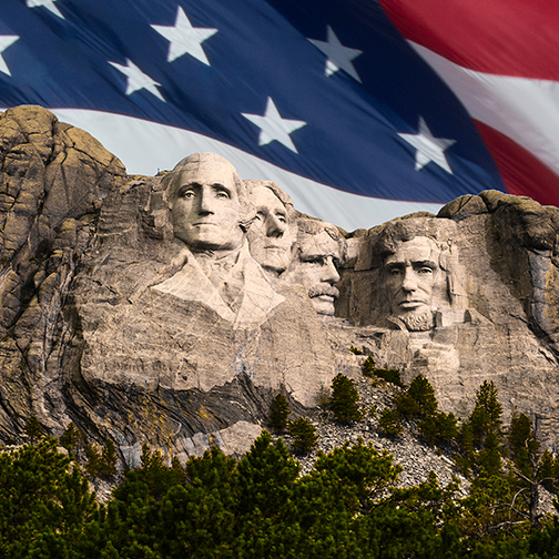 image of Mount Rushmore with an American Flag keyed into background