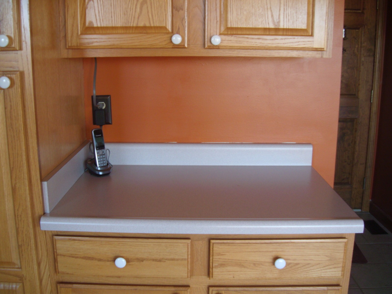 Burnt Orange Kitchen Walls with Oak Cabinets