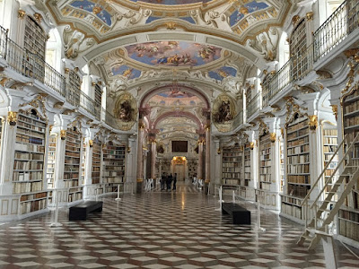 A photo of a library, because research shows using your school's library can can bring your grades up