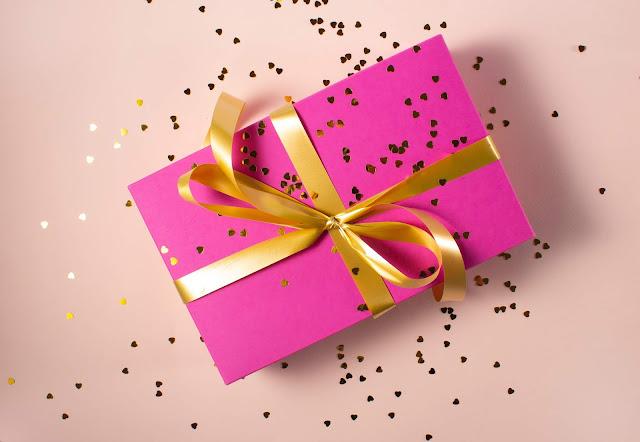 wrapped gift.Photo by Ekaterina Shevchenko on Unsplash