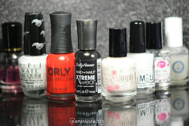 Duri Rejuvacote, O.P.I. Angel With A Lead Foot, Orly Haute Red, Sally Hansen Xtreme Wear Black Out, Bliss Kiss Simply Peel Latex Barrier, Mundo De Unas White, Glisten & Glow HK Girl Fast Drying Top Coat, Essie Matte About You