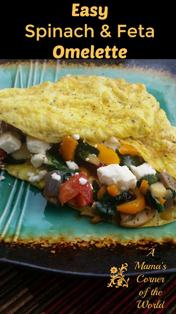Pinnable image for an omelette stuffed with spinach, peppers, onions, tomato, and feta cheese with spices