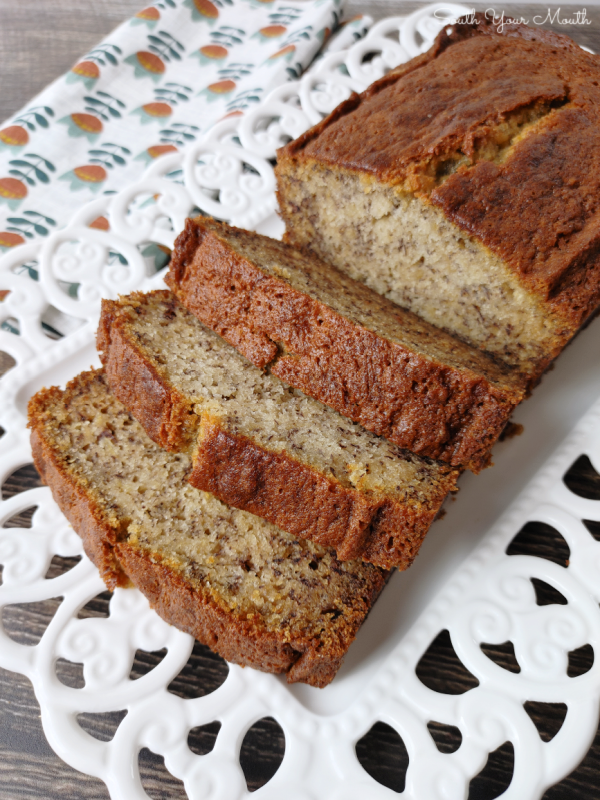 Secret Ingredient SUPER MOIST Banana Bread! The BEST banana bread recipe made incredibly moist by adding a secret ingredient! It may seem odd but once you've made it this way, you'll never make it without it again!