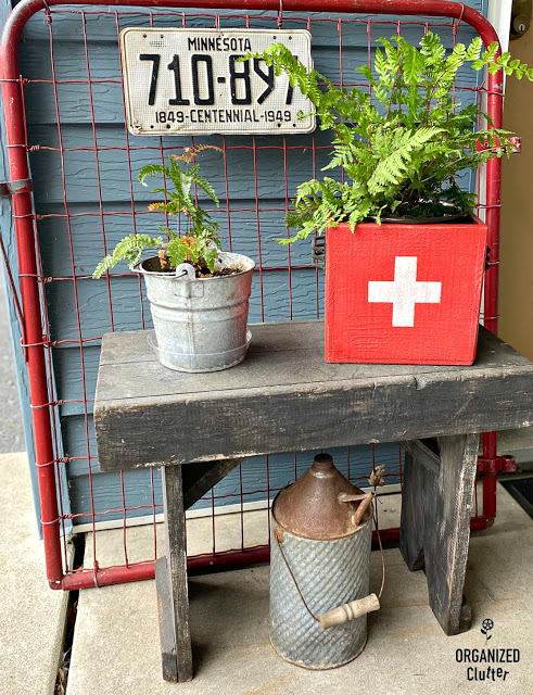 Photo of thrift shop box upcycled with paint and a Swiss Cross stencil