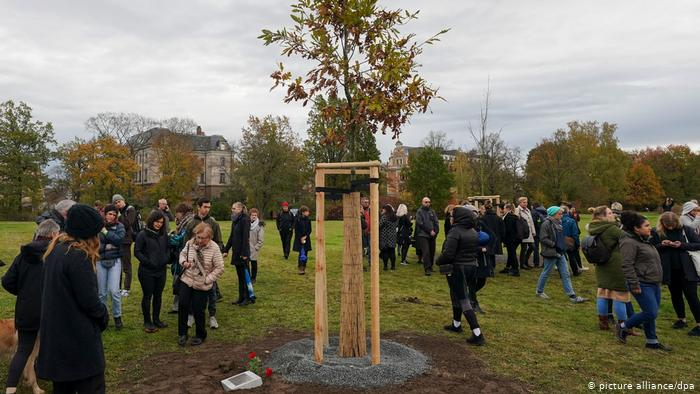 At each of the ten trees a plaque with the name of one of the victims is embedded in the ground