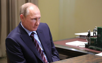 Vladimir Putin at a meeting with Chairman of Federation of Independent Trade Unions Mikhail Shmakov.