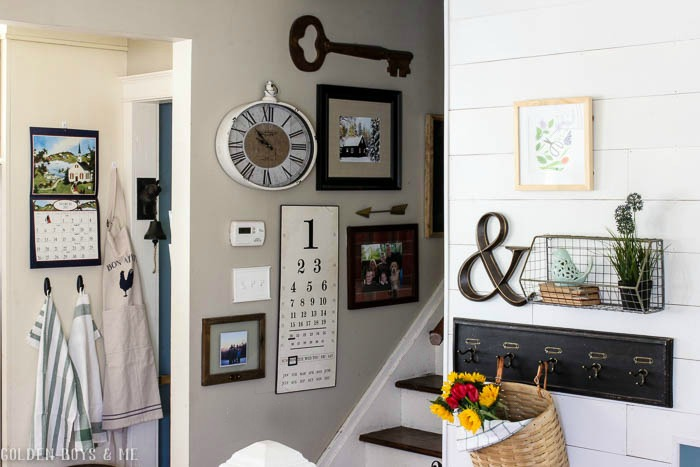 Gallery wall with hooks and wire basket