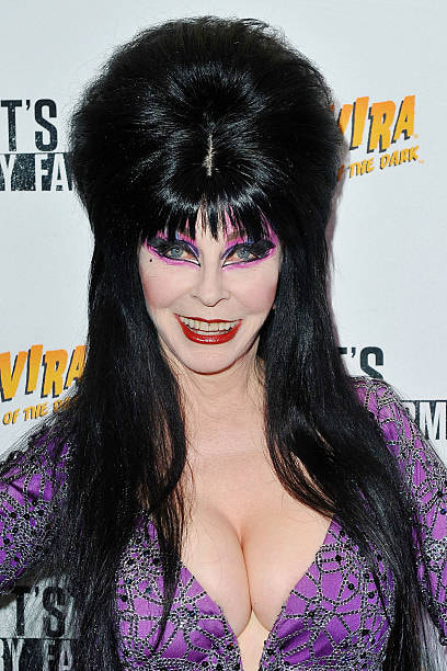 Close up of Elvira in purple gown