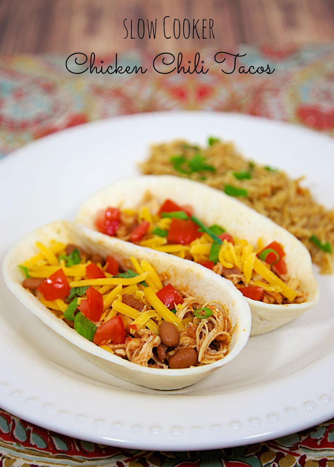 Slow Cooker Chicken Chili Tacos - only 3 ingredients! Great for tacos, topping a salad, or nachos. Makes a ton! Freeze leftovers for later. Everyone loves this easy Slow Cooker Mexican Chicken recipe!