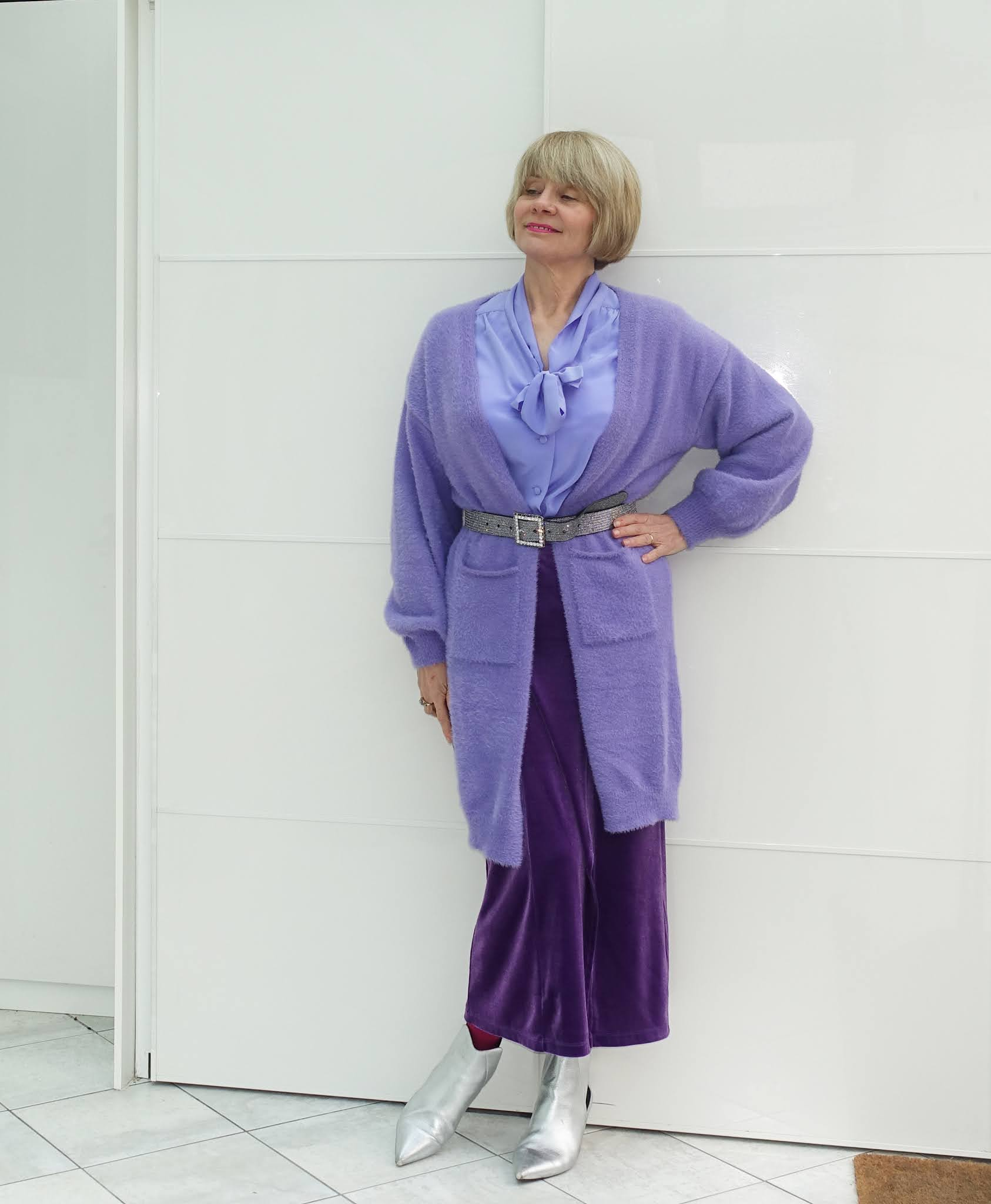 Over 50s blogger Gail Hanlon from Is This Mutton in lilac blouse, long cardigan and purple skirt