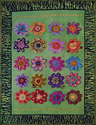 Memories, a wall quilt by Roberta Roberts, embroidery on wool applique