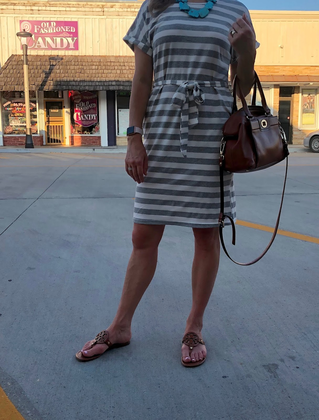 grey striped tee shirt dress, tory burch miller sandals, turquoise necklace, turquoise scarf headband, cognac satchel