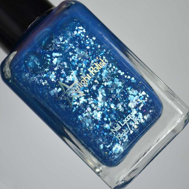 blue glitter nail polish in a bottle