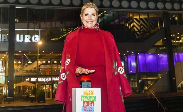 Queen Maxima wore a claret multi embroidered wool cashmere coat from Oscar de la Renta, and a red open-back midi dress from Massimo Dutti