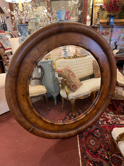 wood, cane, and bamboo-framed circular mirror