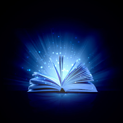 a book is open surrounded by the lights of magical dust