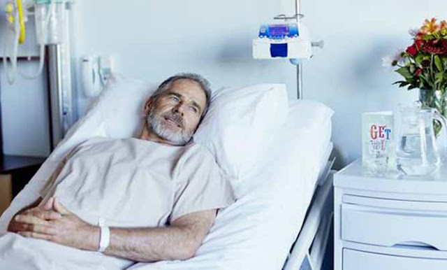 A man on a sickbed in the hospital