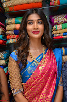 Puja Hegde looks stunning in Red saree at launch of Anutex shopping mall ~ Celebrities Galleries 065.JPG