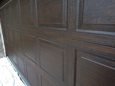 garage door painted to look like dark wood