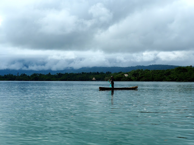 Local fishing from his boat on Lake Izabal, Guatemala