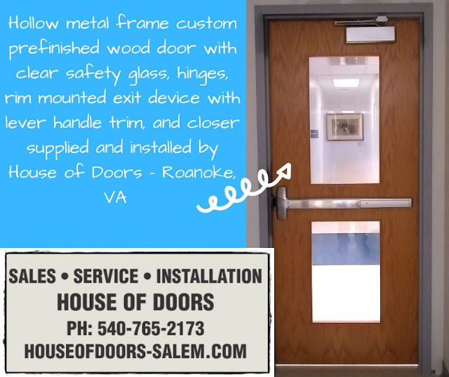 Hollow metal frame custom prefinished wood door with clear safety glass, hinges, rim mounted exit device with lever handle trim, and closer supplied and installed by House of Doors - Roanoke, VA