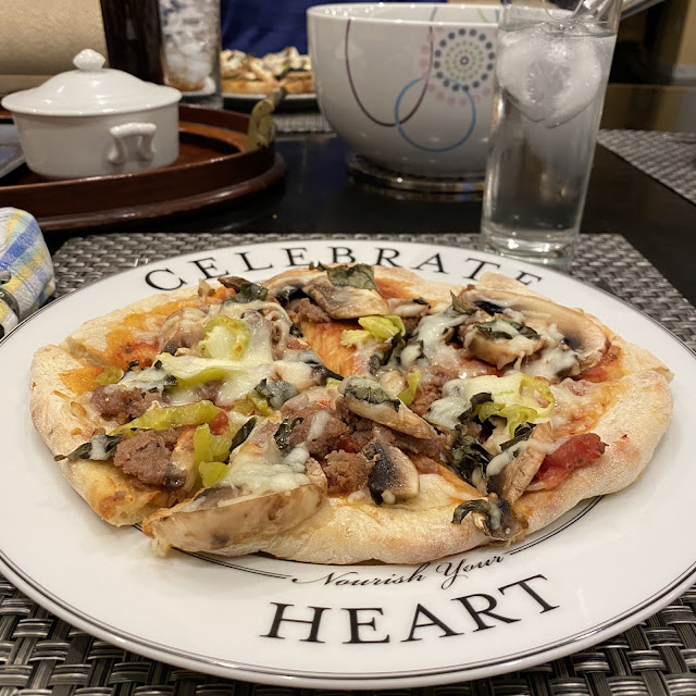 Finished Homemade Pizza on Celebrate Portion Control Dinner Plate Pattern