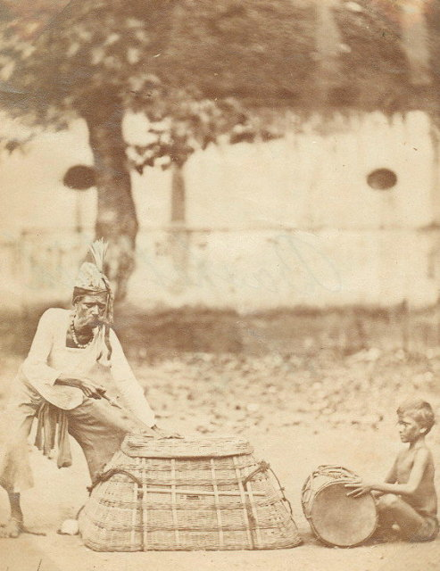 Magician showing Indian Basket Trick - c1870