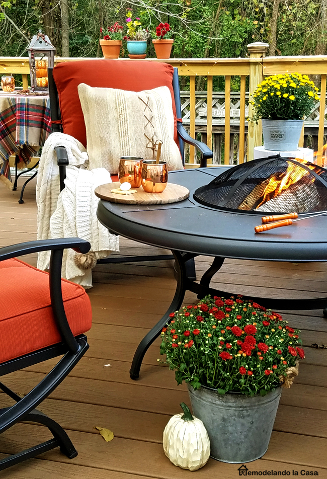 red metal patio set with firepit on floating deck