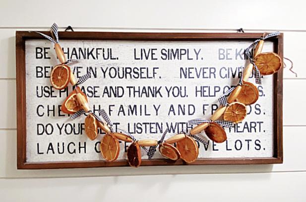 orange slice garland on a sign